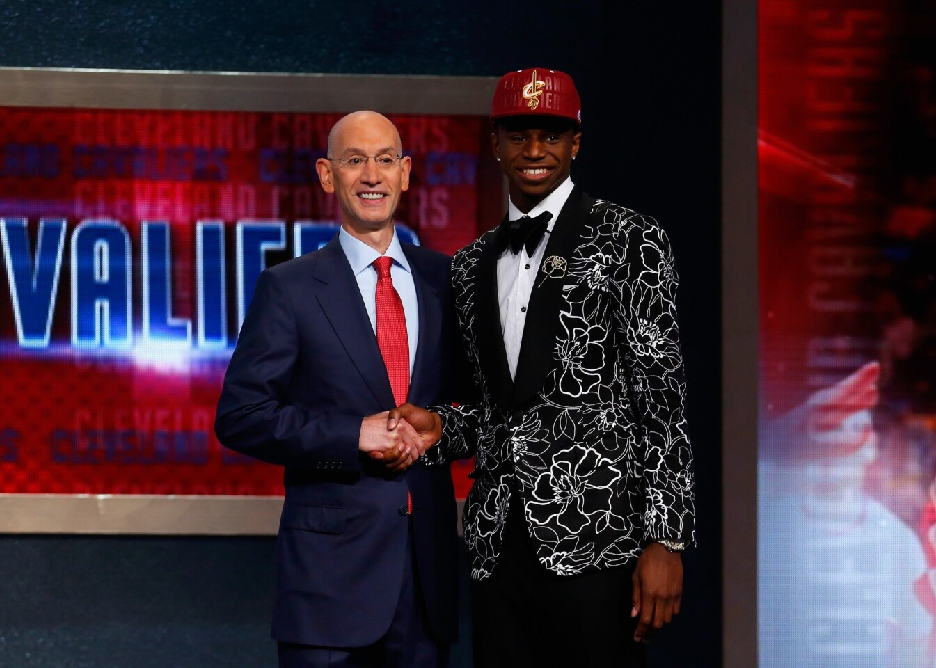 The Cavaliers selected Kansas small forward Andrew Wiggins, right, with the No. 1 overall pick.