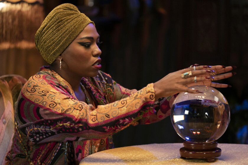 """Laci Mosley looks into a crystal ball as a psychic in """"A Black Lady Sketch Show"""" on HBO."""