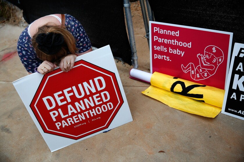 An antiabortion protester demonstrates in front of a proposed Planned Parenthood location in Washington on Sept. 21.