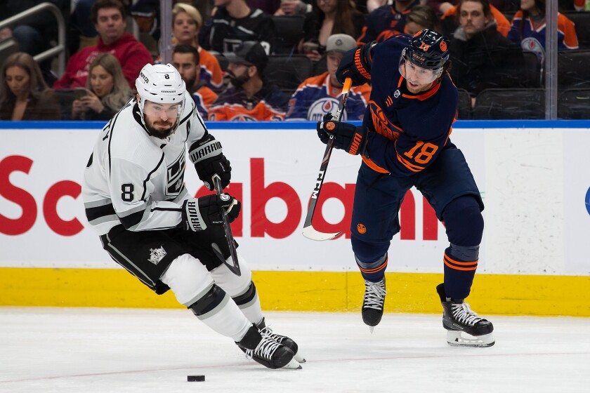 Edmonton Oilers' James Neal (18) battles for the puck against Kings' Drew Doughty (8) on Friday in Edmonton, Canada.