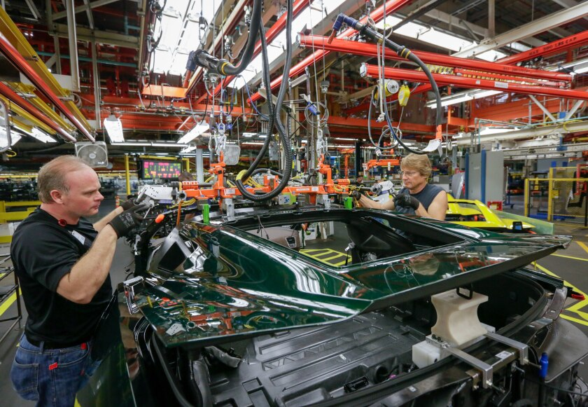 General Motors workers in Bowling Green, Ky., install the hatch on a 2014 Chevrolet Corvette Stingray.