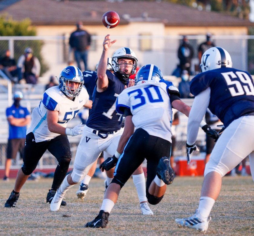 Venice quarterback Sam Vaulton throws a pass during the Gondoliers' 36-0 victory over Palisades.