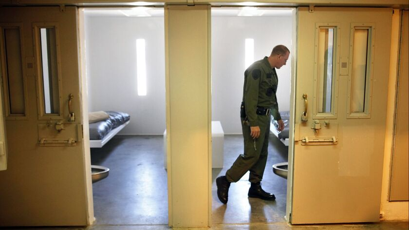 In this Aug. 27, 2010 photo, Investigative Services Lt. Eric Moore looks inside a single occupancy c