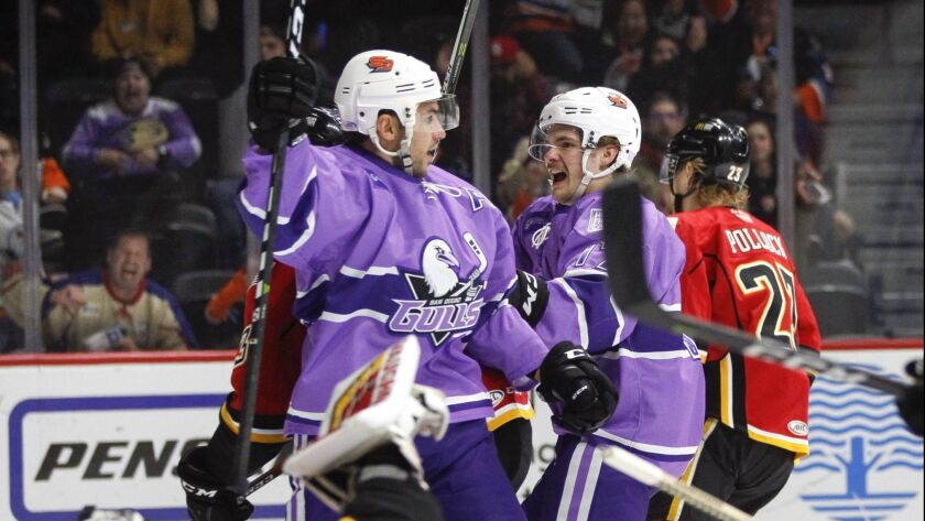 Corey Tropp celebrates a Nov. 23 goal against Stockton with Sam Steel, right. The San Diego Gulls own a franchise record with points in 14 consecutive games.