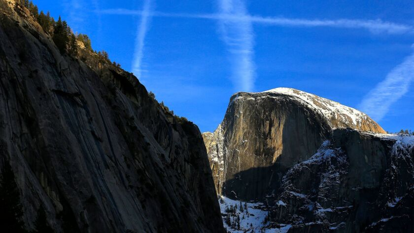Dusted with snow, Half Dome has attracted climbers for decades.