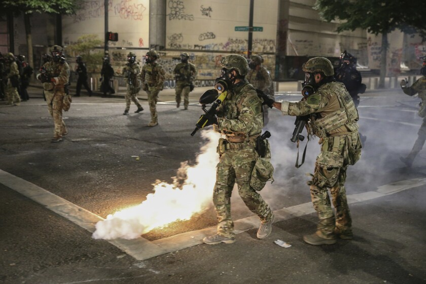 Militarized federal agents deployed by the president to Portland  fired tear gas against protesters.