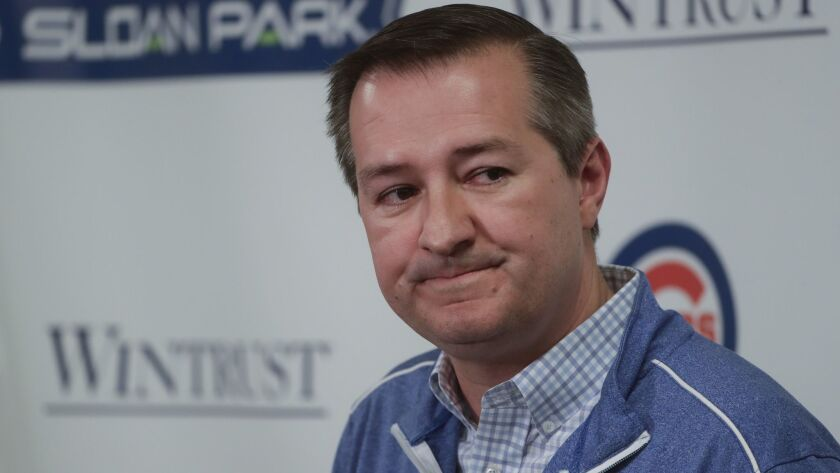 Chicago Cubs chairman Tom Ricketts answers questions during a news conference at a spring training b