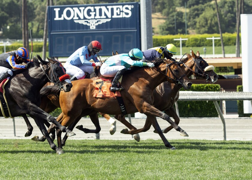 United, right, with Flavien Prat aboard, overpowers Rockemperor, outside, with Irad Ortiz, Jr. aboard, to win the Grade II, $200,000 Charles Whittingham Stakes horse race Saturday at Santa Anita Park in Arcadia, Calif.