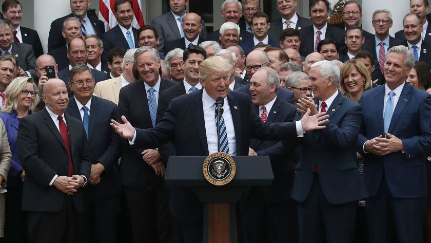 WASHINGTON, DC - MAY 04: U.S. President Donald Trump (C) speaks while flanked by House Republicans
