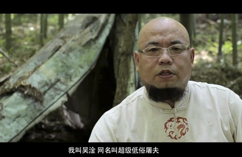 """In this image taken from a July 10, 2012, video provided to APTN, activist Wu Gan is seen with the subtitle """"I am Wu Gan. My internet name is """"Super Vulgar Butcher"""" in Sanming city in southeastern China's Fujian province. Wu was formally arrested in July 2015 as part of a recent crackdown on a loosely allied group of more than 200 """"rights-defender lawyers"""" and the activists associated with them. He is among dozens who remain detained and may eventually stand trial. (Photo via AP Video) CHINA OUT"""
