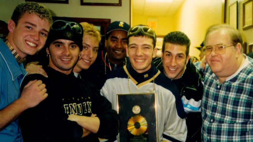 Justin Timberlake, left, Chris Kirkpatrick, Lance Bass, manager Johnny Wright, JC Chasez and Joey Fatone with Lou Pearlman -- the criminal who created 'N Sync.