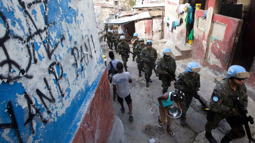 In this Feb. 22, 2017 photo, U.N. peacekeepers from Brazil patrol the Cite Soleil slum in Port-au-Pr