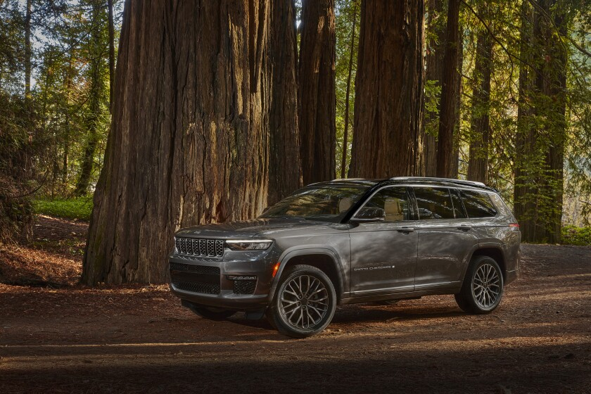 This photo provided by Fiat Chrysler shows the 2021 Jeep Grand Cherokee L Summit Reserve. Fiat Chrysler unveiled the Grand Cherokee L on Thursday, Jan. 7, 2021 and said production would start by the end of March. The company invested $1.6 billion to revamp two old engine plants so they could build new versions of the popular SUV. (Fiat Chrysler via AP)