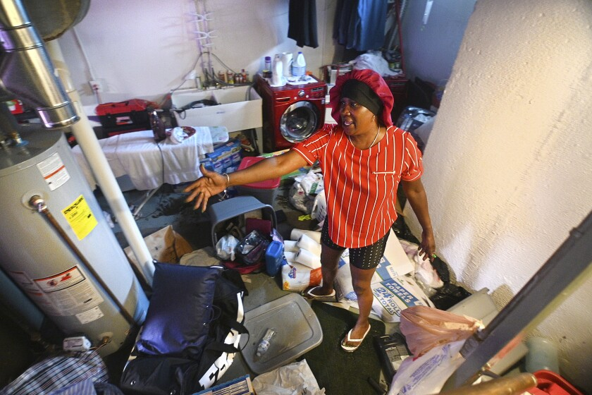 FILE - In this Saturday, June 26, 2021, file photo, Mary Mason shows her frustration after floodwaters damaged her basement in Detroit. A regional water authority board has formed a committee to look at the agency's response to last month's heavy rainfall that led to basement and street flooding in Detroit and some surrounding suburbs. (Max Ortiz/Detroit News via AP, File)