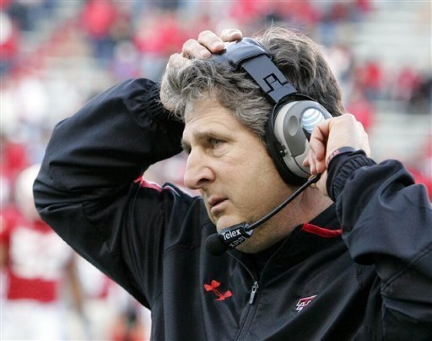 FILE - In this Oct. 17, 2009, file photo, Texas Tech head coach Mike Leach adjusts his head set in the final minutes of an NCAA college football game against Nebraska, in Lincoln, Neb. A Texas judge says former football coach Mike Leach's lawsuit over his firing from Texas Tech can move forward. State District Judge William C. Sowder on Tuesday, June 1, 2010, struck down Texas Tech's claim of sovereign immunity from the lawsuit. (AP Photo/Nati Harnik, File)