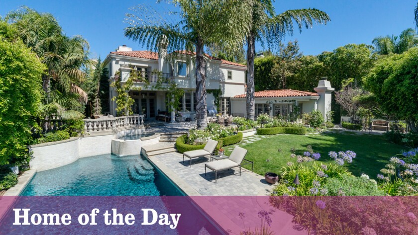This Mediterranean-style home behind gates in the Mulholland Estates community was once owned by pop-rocker Avril Lavigne.