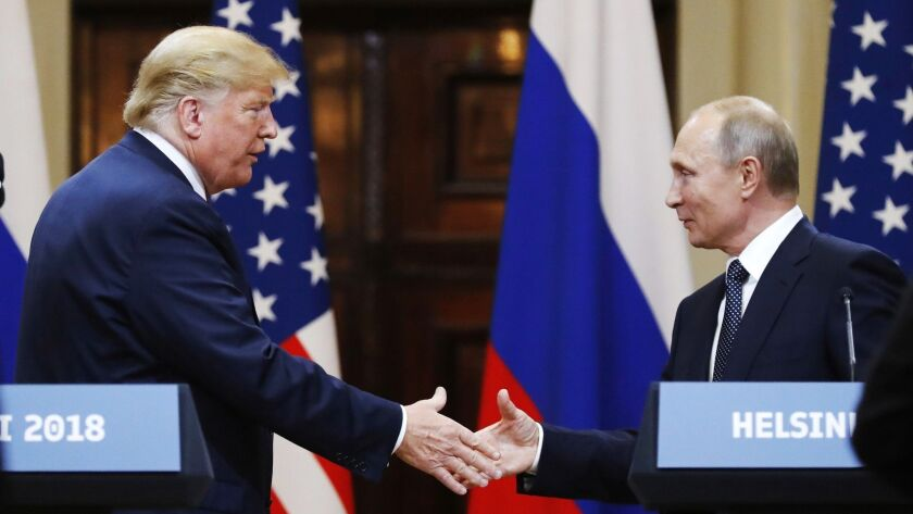 FILE In this file photo taken on Monday, July 16, 2018, U.S. President Donald Trump shakes hand with