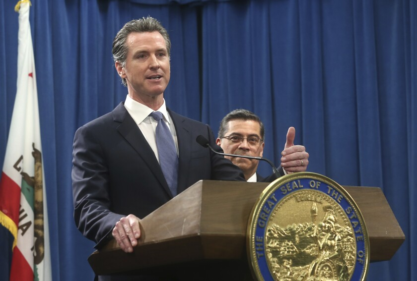 FILE - In this Feb. 15, 2019, file photo, California Gov. Gavin Newsom, left, flanked by Attorney General Xavier Becerra, right, answers a question during a news conference in Sacramento, Calif. With President-elect Joe Biden tapping California's attorney general for his cabinet, Newsom now has the chance to pick California's next top prosecutor and its next U.S. Senator, power that could shape the state's politics for decades to come. (AP Photo/Rich Pedroncelli, File)