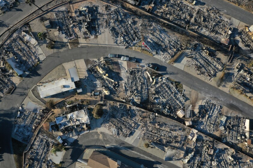 Burned-out mobile homes are seen in an aerial view after a fire in Riverside County.