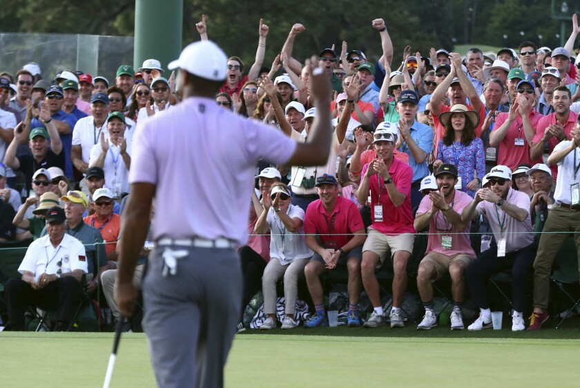 Tiger Woods acknowledges the gallery on 18 during the third round of the Masters golf tournament Saturday, April 13, 2019, at Augusta National in Augusta, Ga.