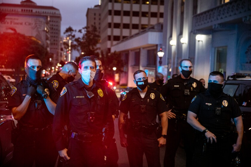 SDPD officers stand guard on Sixth Avenue in Downtown San Diego where San Diego Police Department officers shot a man.