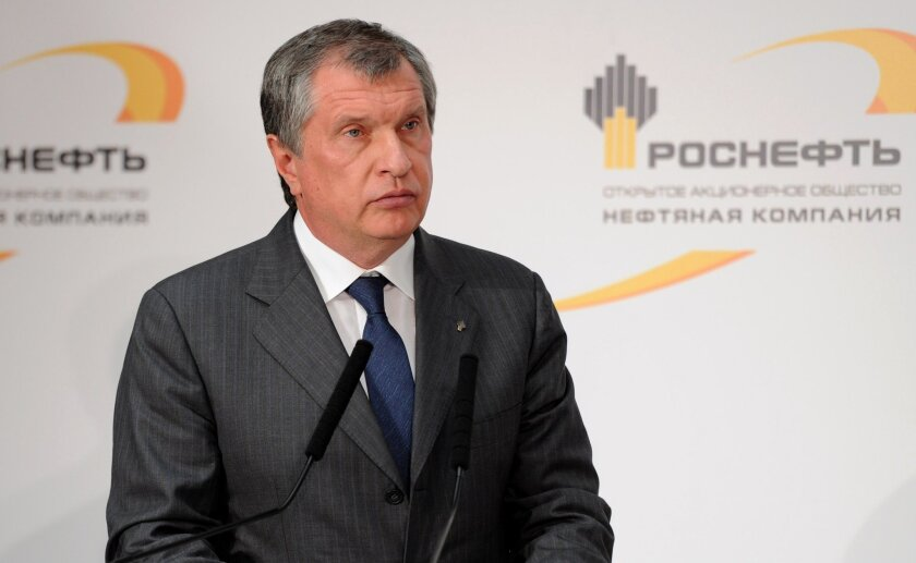 FILE - In this Friday, Oct. 11, 2013 file photo CEO of state-controlled Russian oil company Rosneft Igor Sechin commissions new equipment at the Rosneft oil refinery in the Black Sea port of Tuapse, southern Russia. The U.S. Department of the Treasury on Monday, April 28, 2014, designated seven Russian government officials, including two key members of the Russian leadership's inner circle, and 17 entities pursuant to Executive Order (E.O.) 13661. E.O. 13661 authorizes sanctions on, among others, officials of the Russian Government and any individual or entity that is owned or controlled by, that has acted for or on behalf of, or that has provided material or other support to, a senior Russian government official. Sechin is on the list. (AP Photo/RIA-Novosti, Alexei Nikolsky, Presidential Press Service, File)