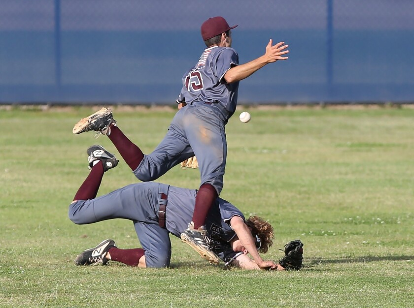 Laguna outfielder Will Potratz tips up shortstop Eric Silva (15) while trying to catch short fly bal