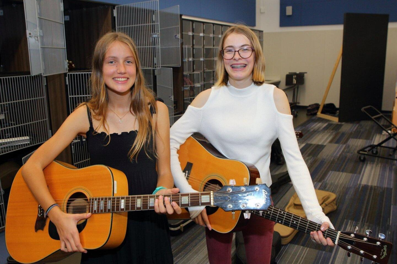 Guitar class members Audrey Schefer and Kamala Oldham