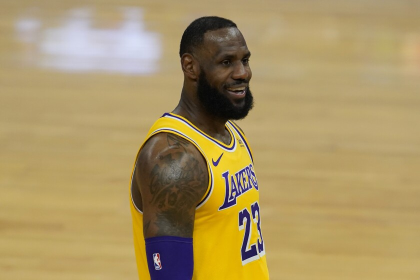 Lakers forward LeBron James smiles during a game against the Golden State Warriors.