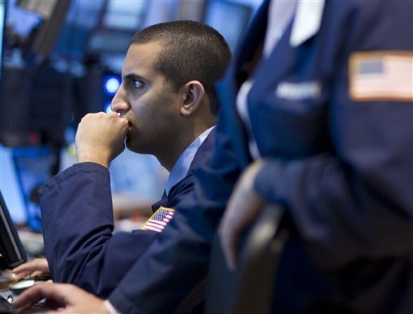 A trader works on the floor of the New York Stock Exchange on Friday, Sept. 2, 2011 in New York. The jobs report was the weakest in almost a year. It renewed fears that the U.S. might slip back into recession. (AP Photo/Jin Lee)