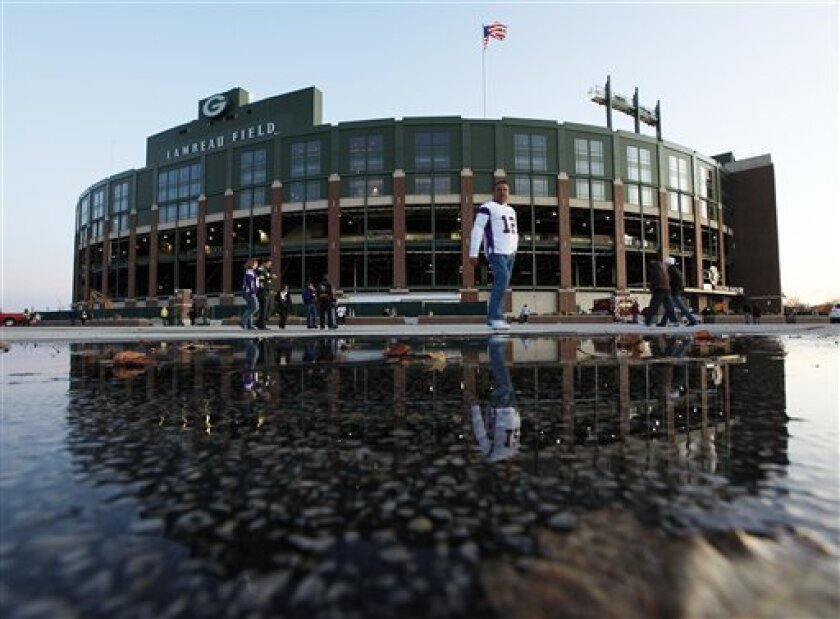 Fans make their way to Lambeau Field before an NFL football game between the Green Bay Packers and the Minnesota Vikings Monday, Nov. 14, 2011, in Green Bay, Wis. (AP Photo/Mike Roemer)
