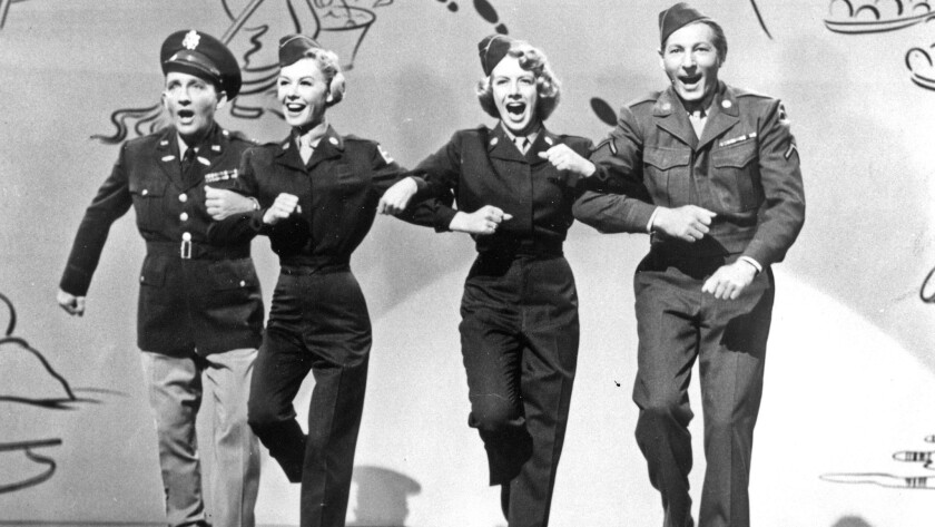 "Bing Crosby, left, Vera–Ellen, Rosemary Clooney and Danny Kaye in ""White Christmas"" (1954)."