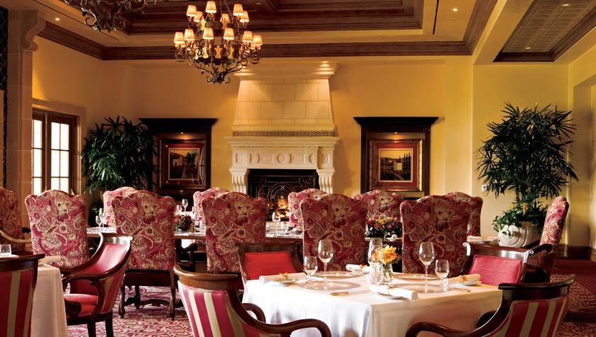"""Addison's dining room, seeped in old-world splendor, is scheduled for a refresh in 2017. (Insider tip: don't worry if you soil the tablecloth with a spill; a server will discreetly place what we affectionately call """"the napkin of shame"""" over it."""