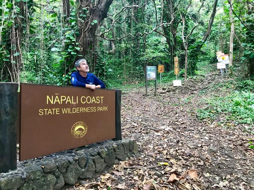 Alan Carpenter stands at the trailhead of the Kalalau Trail along the famed Napali Coast on Kauai.
