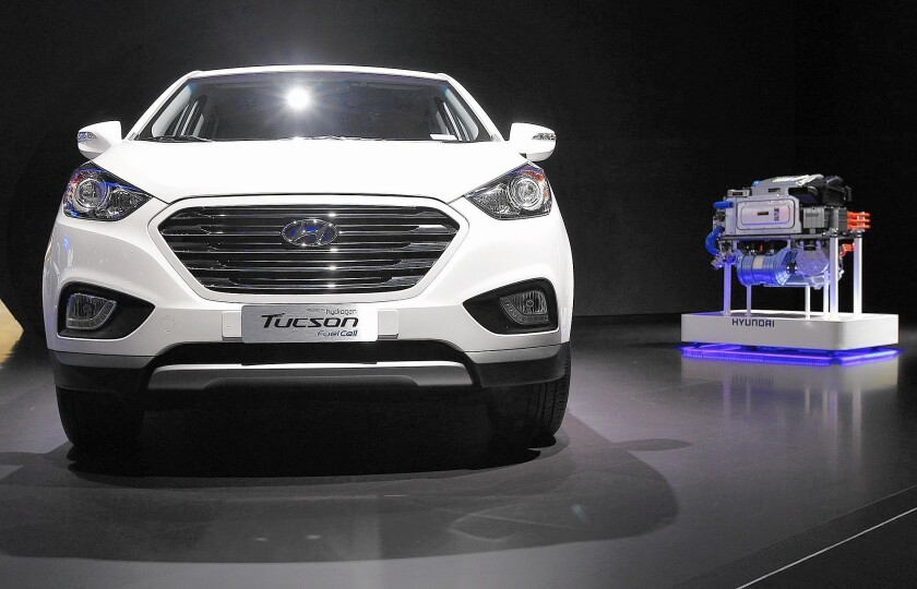 Hyundai started leasing a hydrogen fuel cell version of its Tucson SUV, above, this year. To the right is a fuel cell stack on display at the 2013 L.A. Auto Show.