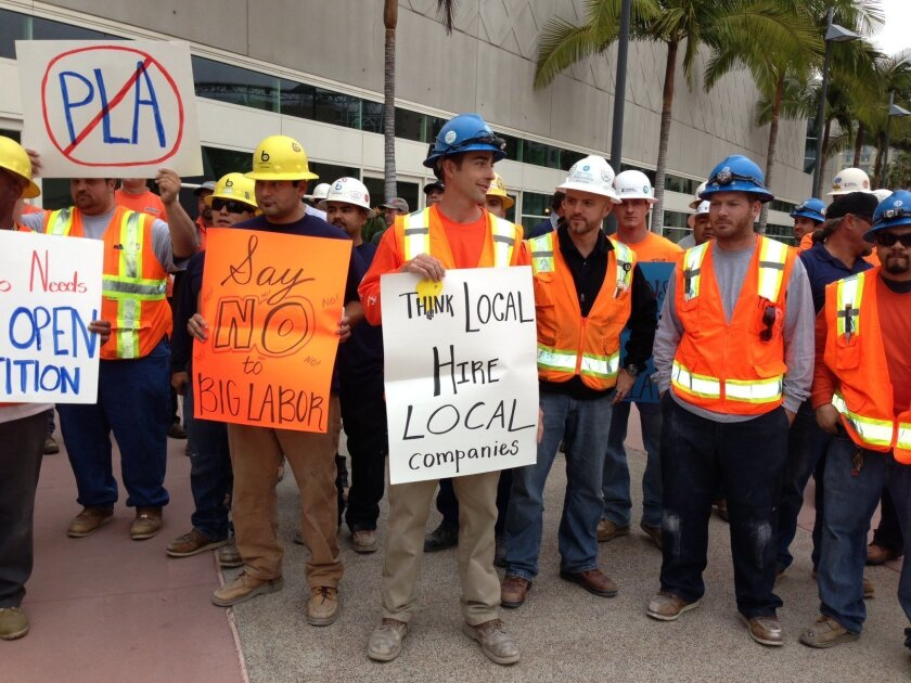 Non-union workers last year staged a protest over a labor pact governing hiring for convention center expansion project.