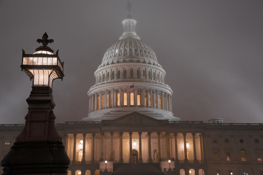 The U.S. Capitol in Washington is shrouded in mist, Friday night, Dec. 13, 2019. House impeachment of President Donald Trump on Wednesday underscores how Democrats and Republicans have morphed into fiercely divided camps since lawmakers impeached President Bill Clinton.