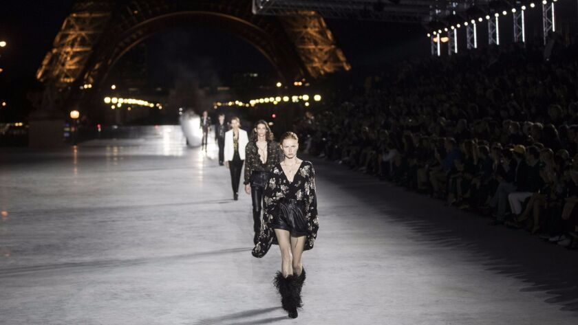 The finale of the spring and summer 2018 runway collection show presented against the backdrop of the Eiffel Tower on Sept. 26 during Paris Fashion Week.
