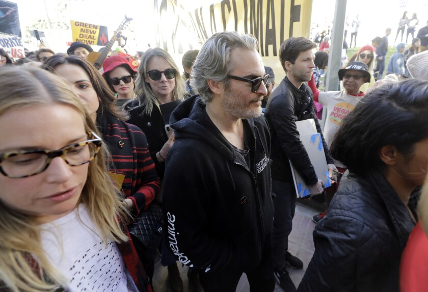 Actor Joaquin Phoenix was among protesters Friday in front of City Hall.