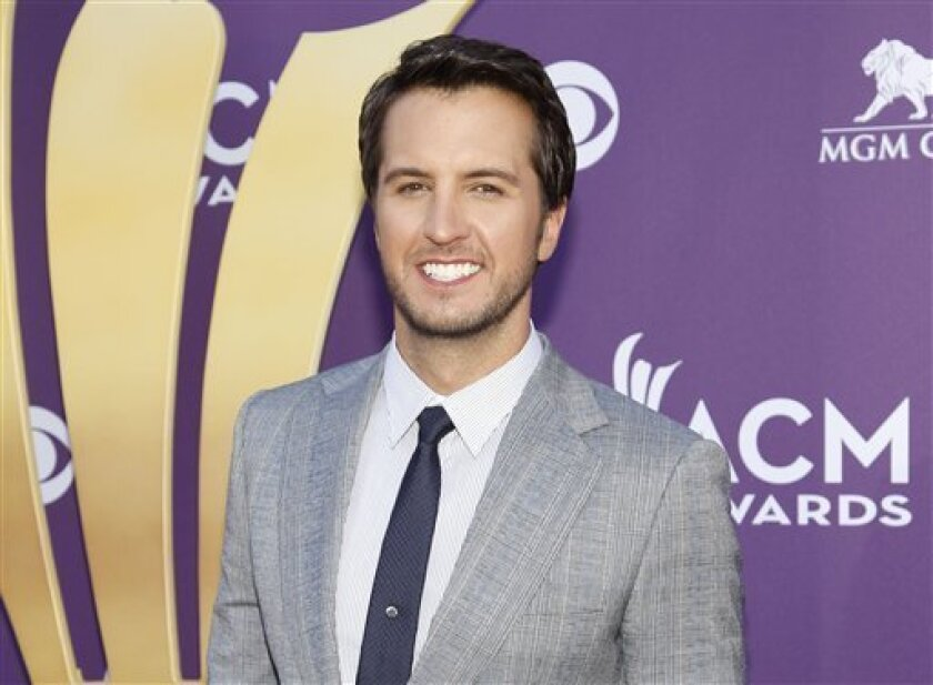 """FILE - This April 1, 2012 file photo shows country singer Luke Bryan at the 47th Annual Academy of Country Music Awards in Las Vegas. Bryan is joining Blake Shelton to co-host the 2013 Academy of Country Music Awards. The Academy announced Tuesday, Jan. 8, 2013, this year's show will be held April 7. Bryan replaces Reba McEntire, who served as host for more than a decade before stepping aside to concentrate on her new sit-com """"Malibu Country."""" (AP Photo/Isaac Brekken, file)"""