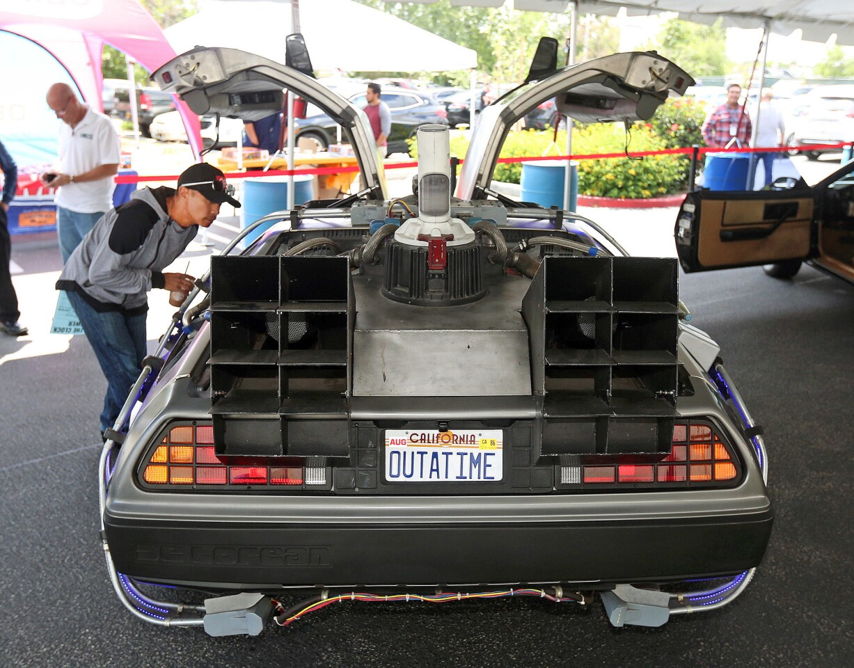 Photo Gallery: Ghostbusters, Back to the Future, Jurassic Park, and Knight Rider cars on display at Burbank Walmart