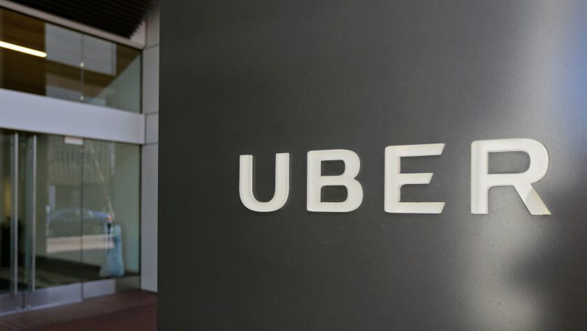 FILE- This March 1, 2017, file photo shows an exterior view of the headquarters of Uber in San Franc
