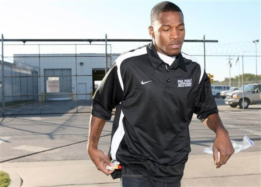 Baylor basketball player Lacedarius Dunn leaves the McLennan County Jail on Tuesday Oct. 5, 2010 in Waco, Texas. Baylor indefinitely suspended leading scorer LaceDarius Dunn on Tuesday after he surrendered to police to face an aggravated assault charge accusing him of breaking his girlfriend's jaw during an argument last week. (AP Photo/Waco Tribune Herald, Duane A. Laverty) MANDATORY CREDIT
