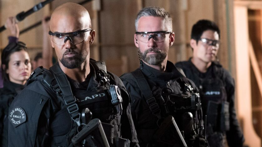 """Shemar Moore and Jay Harrington (with Lina Esco and David Lim out of focus behind them) are cops with better weapons in the CBS revival of """"S.W.A.T."""""""
