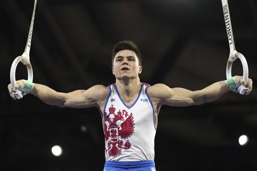 Nikita Nagornyy of Russia performs on the rings in the men's all-around final at the Gymnastics World Championships in Stuttgart, Germany, Friday, Oct. 11, 2019. (AP Photo/Matthias Schrader)