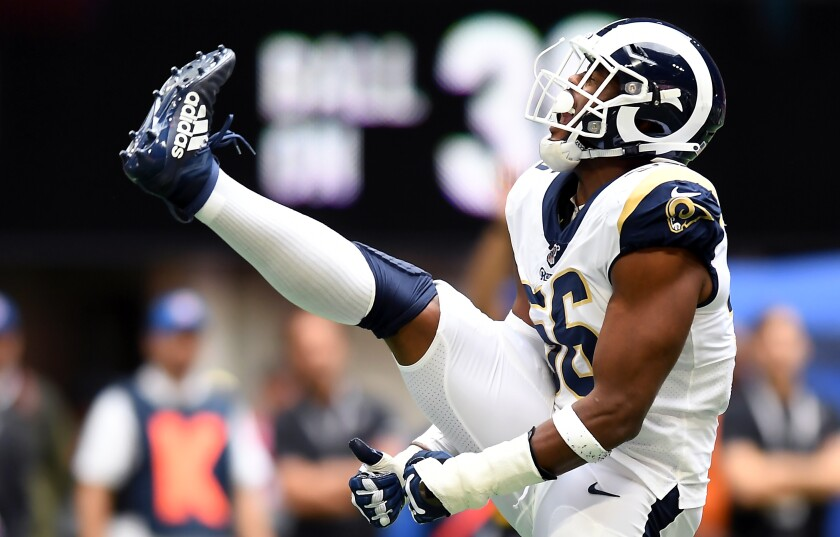 Rams' Dante Fowler Jr. celebrates one of his career-high three sacks against the Falcons