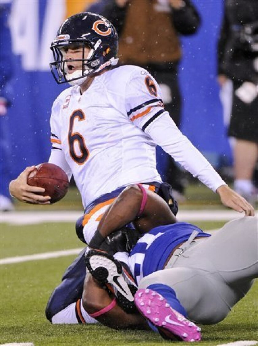 Chicago Bears quarterback Jay Cutler (6) is sacked by New York Giants defensive end Justin Tuck (91) during the second quarter of an NFL football game at New Meadowlands Stadium Sunday, Oct. 3, 2010, in East Rutherford, N.J. (AP Photo/Bill Kostroun)
