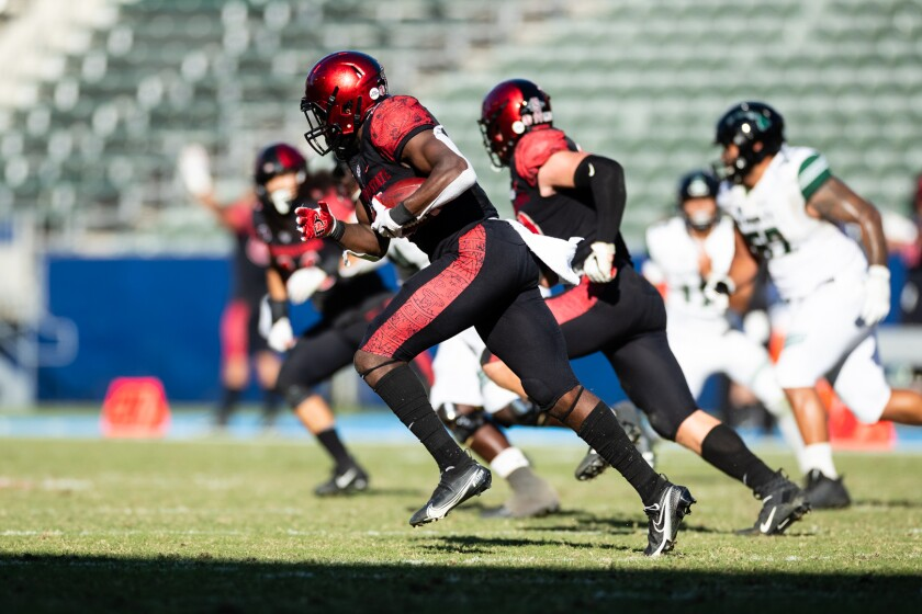 Aztecs linebacker Segun Olubi returns an interception 71 yards for a touchdown during a win against Hawaii last November.