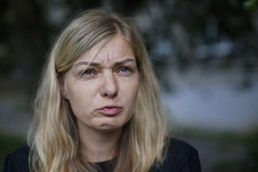 Elena German reacts as she speaks during her interview with the Associated Press in Minsk, Belarus, Saturday, Aug. 15, 2020. Alexander Taraikovsky's life-partner Elena German told The Associated Press on Saturday that she is sure her 34-year-old mate was shot by police. German spoke a few hours before Taraikovsky's funeral and burial, an event that could reinforce the anger of demonstrators who for the past have protested what they consider a sham presidential election and the violent police response to their protests. (AP Photo/Mstyslav Chernov)