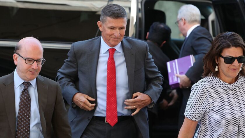 Michael Flynn, center, arrives at court in Washington in July.